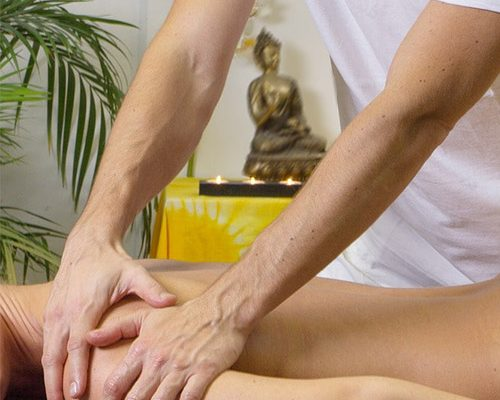 patient getting massage theraphy to relieve back pain